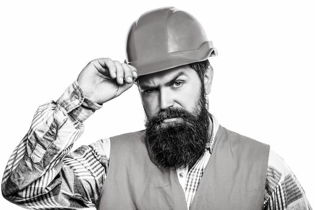 Mensenbouwers, industrie. portret architect bouwer, burgerlijk ingenieur werken. bouwer in harde hoed, voorman of reparateur in de helm.