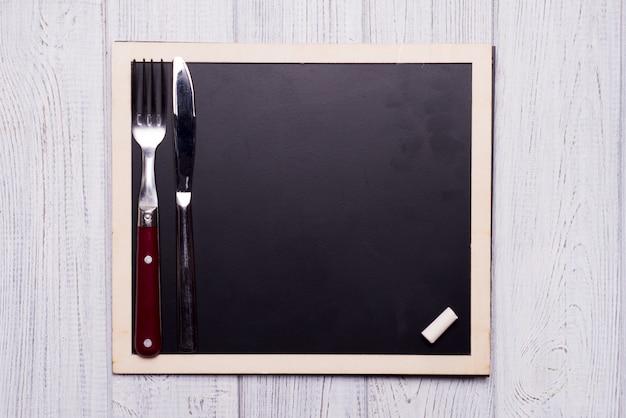 Menu schoolbord met mes en vork
