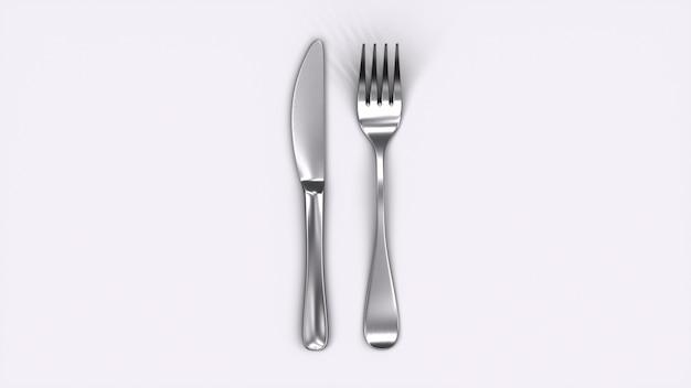 Mes en vork die op witte achtergrond wordt geïsoleerd