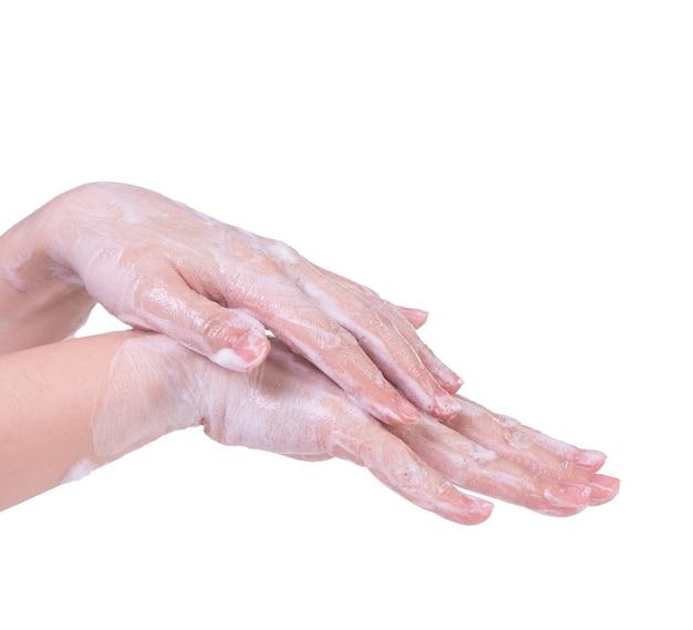 Met behulp van vloeibare zeep om hand te wassen geïsoleerd op wit.