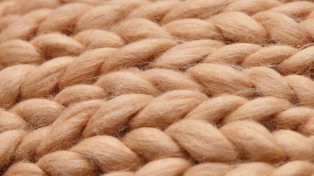 Met de hand gemaakte gebreide grote deken van merinowol