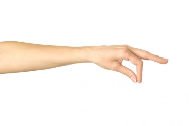 Met de hand plukken, vasthouden, grijpen of bereiken. vrouwenhand gesturing geïsoleerd op wit