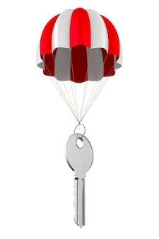 Metaalsleutel en parachute op wit