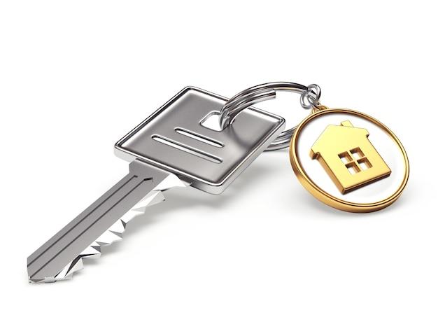 Metalen sleutel en ronde sleutelhanger met huisje