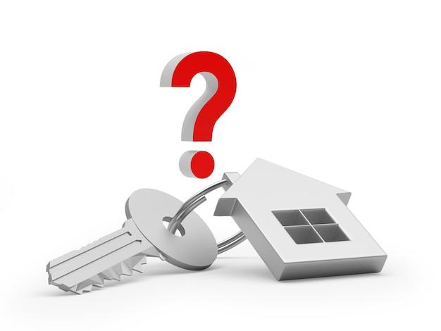 Metalen sleutel met een huissleutelhanger en een vraagteken