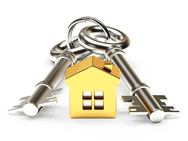 Metalen sleutels met gouden huisfiguur