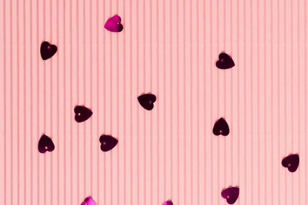 Metallic hart confetti roze behang