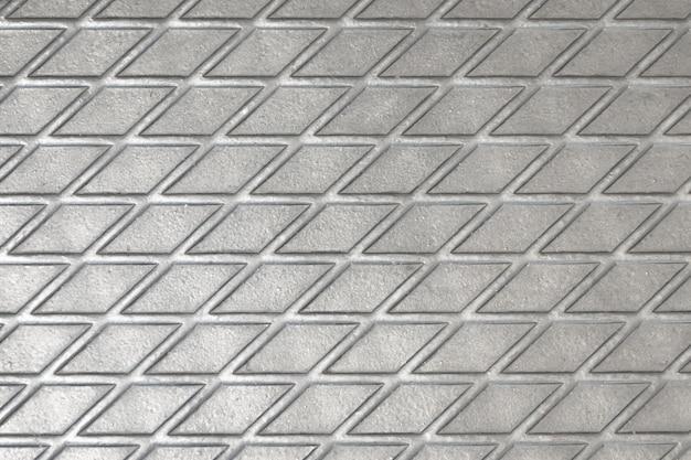 Metallic textuur van een reelf glanzende diamant kleur vierkanten van lijnen die elkaar kruisen.