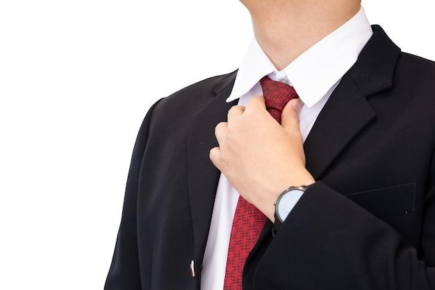 Middelgroot geschoten bedrijfsmensenlichaam in zwart kostuum met stropdas van de handholding