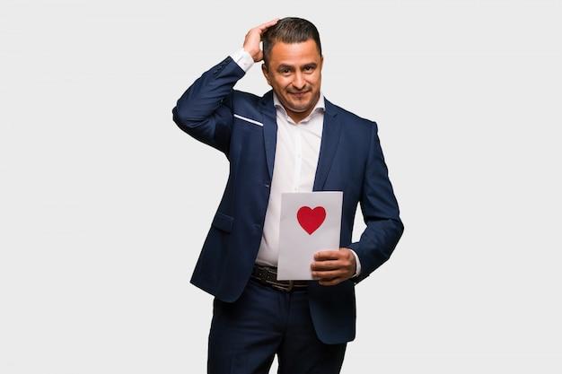 Midden leeftijd latijns-man vieren valentijnsdag bezorgd en overweldigd