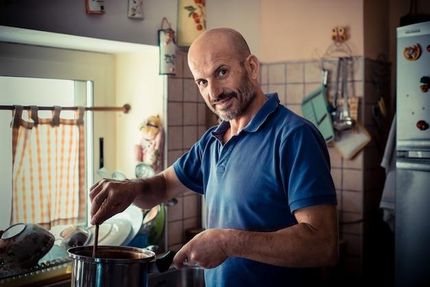 Miggle age man cooking
