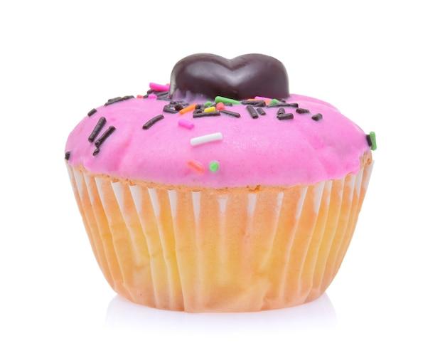 Mini smakelijke cupcake die op witte achtergrond wordt geïsoleerd