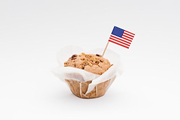 Miniatuurvlag van amerika de vs met zoete cupcake