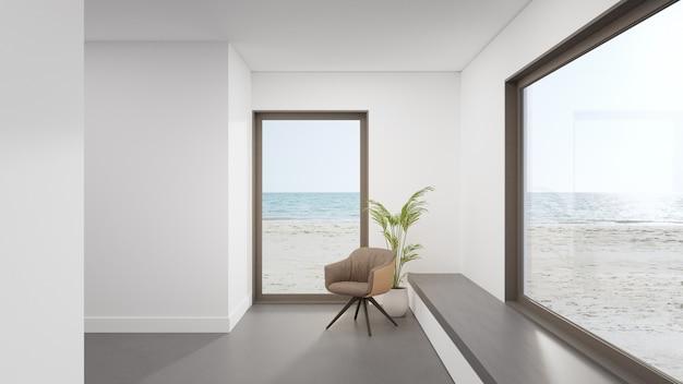 Minimale interieur 3d-rendering met uitzicht op het strand en de zee.
