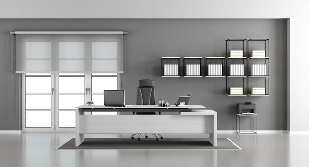 Minimalistisch modern bureau, bureaustoel en boekenkast