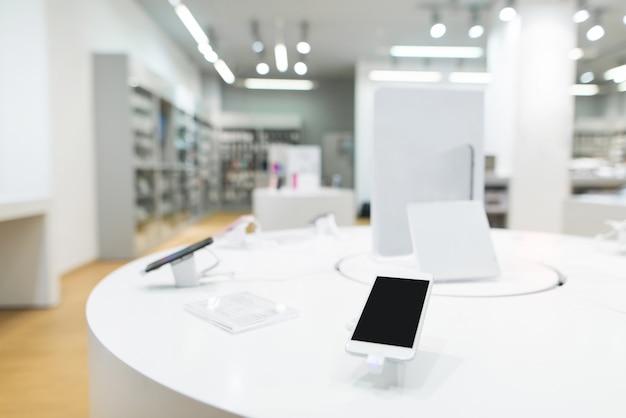 Ministerie van mobiele telefoons in de tech-winkel. moderne gadgetwinkel