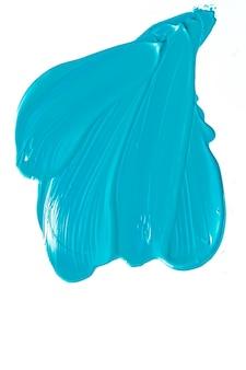 Mint blauwe schoonheid cosmetische textuur geïsoleerd op een witte achtergrond vlekkerige make-up uitstrijkje of cosmetica pro...