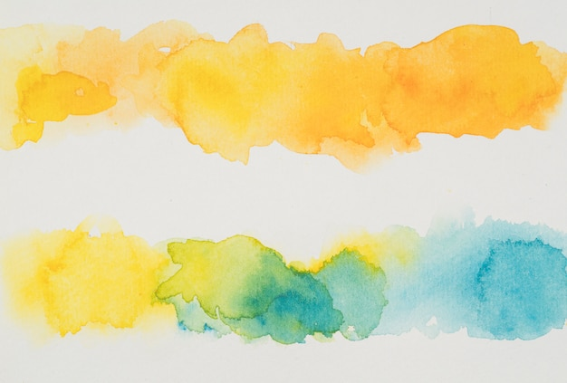 Mix van blauwe en gele waterverf op papier