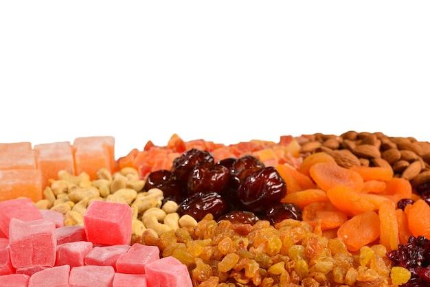 Mix van noten en gedroogde vruchten en zoete turkse lekkernijen achtergrond.