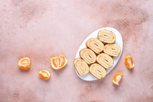Mix van zoete koekjes, cakebroodje, mini cupcakes.