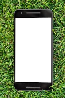 Mobiel slim telefoonmodel met het witte scherm op groene grasachtergrond.