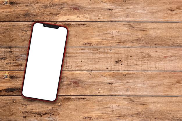 Mobiele telefoon op rustieke tafel