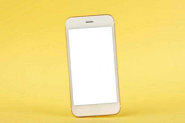 Mobiele telefoonspot omhoog op gele achtergrond
