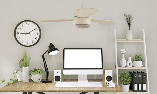 Mock up computer met leeg scherm en decoratie in kantoorruimte mock up achtergrond. 3d-rendering