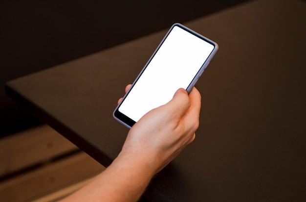 Mock-up hand met telefoon