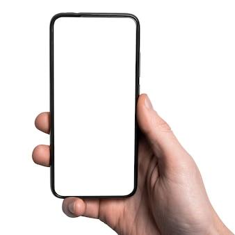 Mock up, mockup. man hand met de zwarte smartphone met frame minder leeg scherm en modern frameloos ontwerp, verticaal - geïsoleerd op een witte achtergrond. uitknippad. ui-ontwerpinterface.