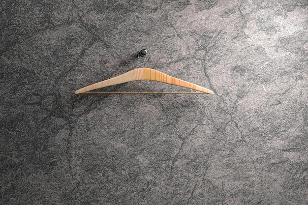 Mockup een kleerhanger op marmeren muur