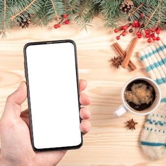 Mockup telefoon op kerstmis achtergrond.