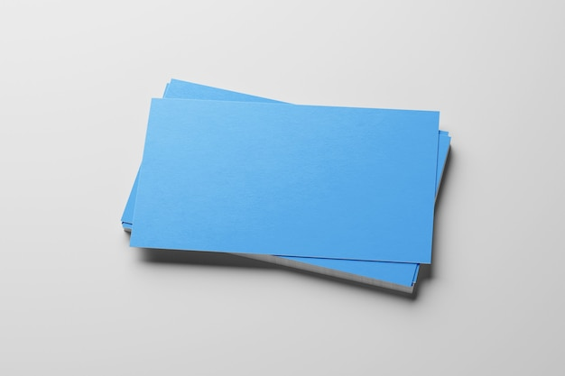 Mockup van blauwe visitekaartjes stapelen op witte geweven papier achtergrond