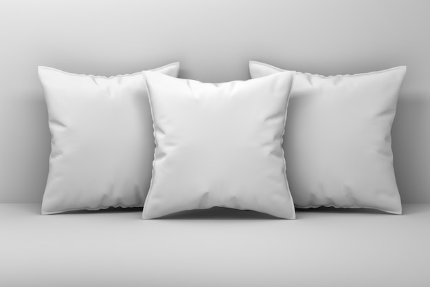 Mockup van drie grote witte kussens