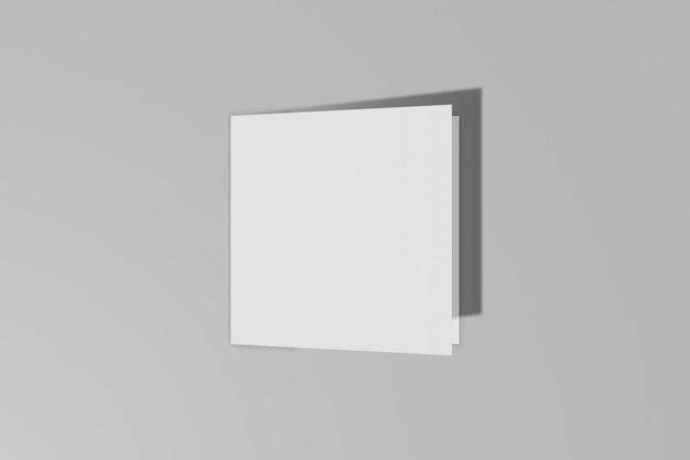 Mockup vierkant boekje, brochure, uitnodiging geïsoleerd op een grijze achtergrond met harde kaft en realistische schaduw. 3d-weergave.