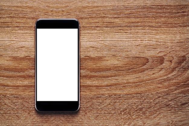 Mockup wit scherm mobiel op oude klassieke houten vloer