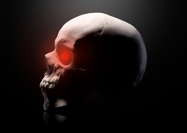 Model van de menselijke schedel met rode ogen geïsoleerd op zwarte achtergrond