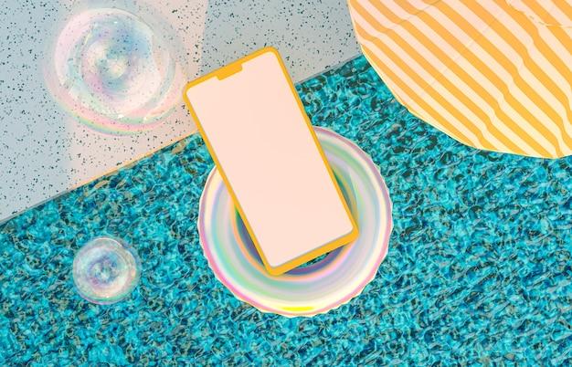 Model van mobiele telefoon drijvend in het zwembad met opblaasbare drijvers