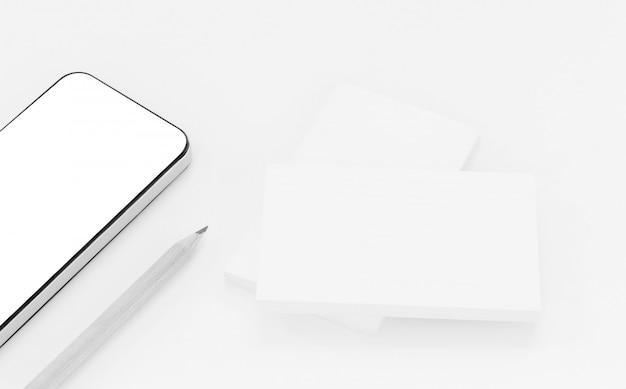 Model van visitekaartjes met slimme telefoon op witte geweven document achtergrond