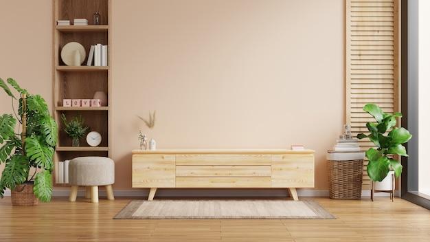Modern interieur van woonkamer met kast voor tv op crèmekleurige muur,