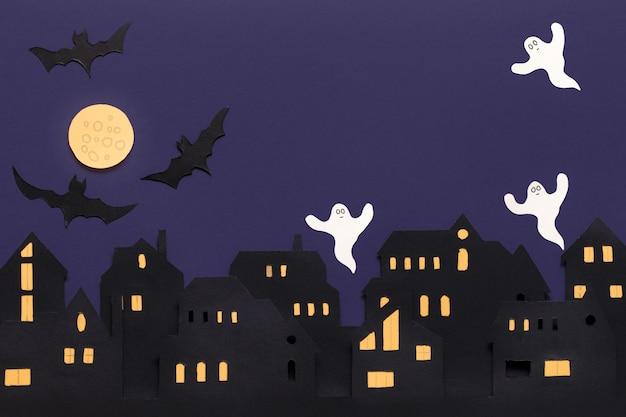 Modern papier gesneden plat lag met zwarte halloween-achtergrond. stripfiguur. ruimte kopiëren