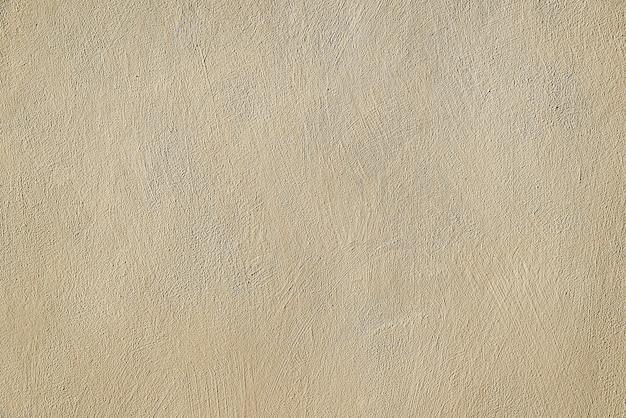 Moderne beige concrete muurtextuur als achtergrond