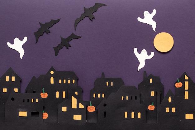 Moderne cadeaubon met halloween op donkere achtergrond halloween in papier gesneden stijl