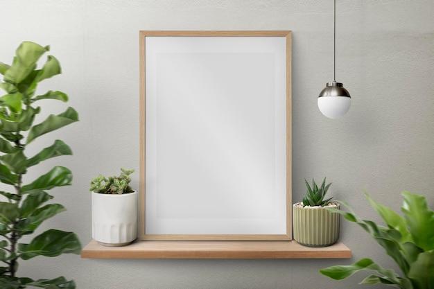 Moderne fotolijst op een plank