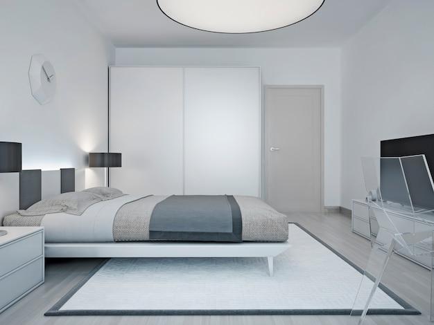 Moderne hotelkamer inrichting met luxe bed met kleerkast met schuifdeur en een grote ronde lamp aan het plafond.