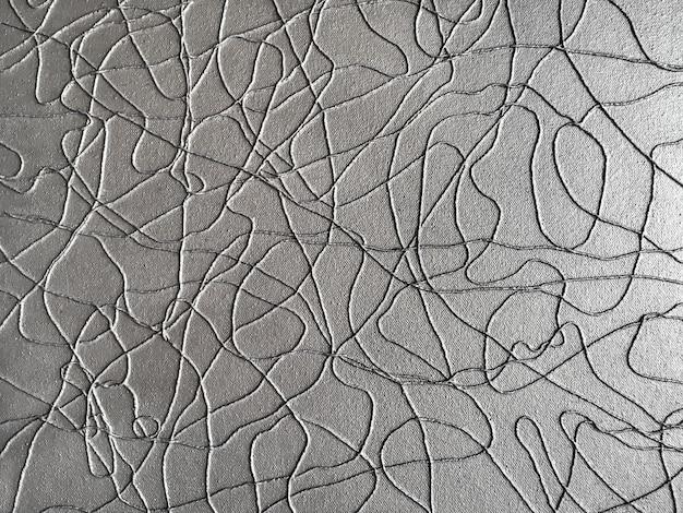 Moderne kunstachtergrond van zilveren kabel op grijs document