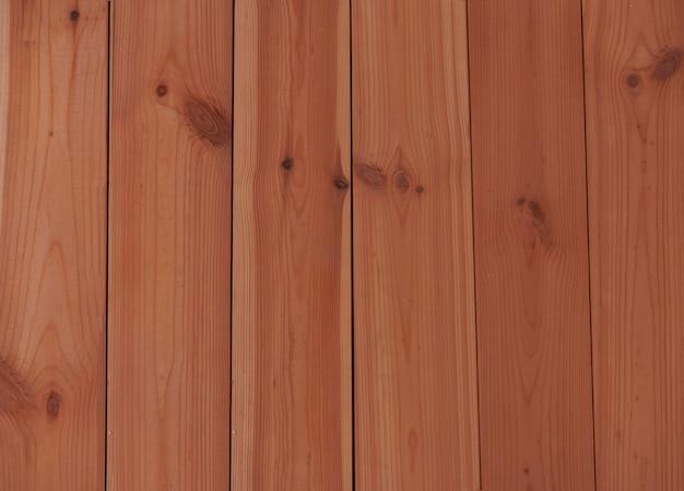 Moderne milieuvriendelijke bouwmaterialen - achtergrond van grenen planken gekleurd met olie