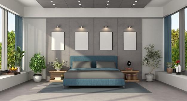 Moderne slaapkamer met blauw tweepersoonsbed op betonnen paneel