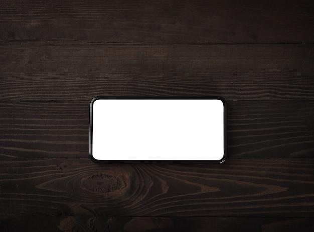 Moderne smartphone op zwarte houten tafel