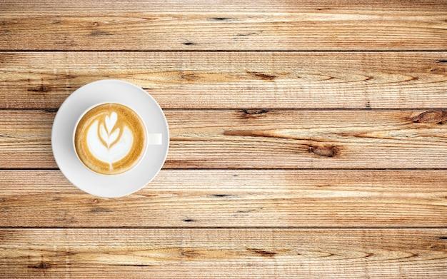Moderne werkruimte met de ruimte van het koffiekopexemplaar op houten achtergrond.
